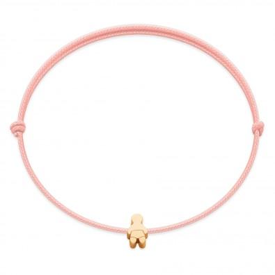 Bracelet avec un bébé Etincelle plaqué or sur un cordon fin rose clair
