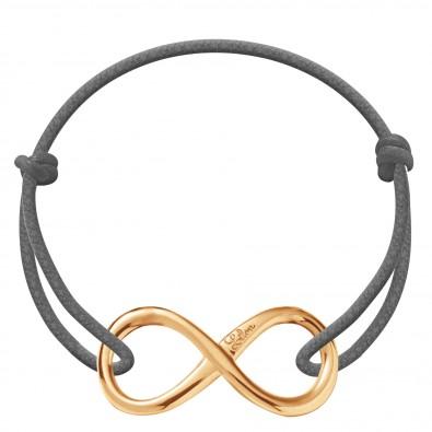 Bracelet avec un signe de l'infini plaqué or sur un cordon épais gris foncé
