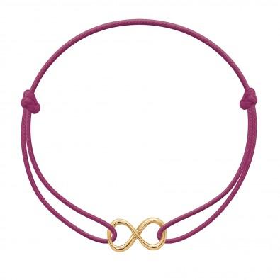 Bracelet avec signe de l'infini plaqué or sur un cordon fin de couleur fuchsia