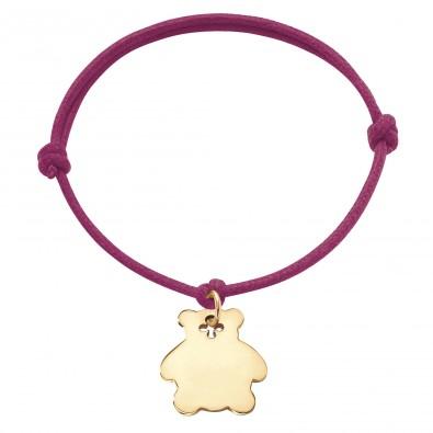 Bracelet avec ourson plaqué or sur un cordon épais de couleur fuchsia