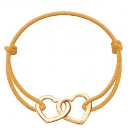 Bracelet avec deux cœurs joints Accroche-cœur plaqués or sur un cordon épais de couleur ensoleillée