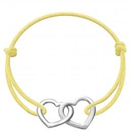 Bracelet avec deux cœurs joints Accroche-cœur en argent sur un cordon épais jaune
