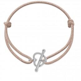 Bracelet avec fermoir en forme d'un cœur en argent sur un cordon épais de couleur beige