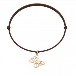 Bracelet avec papillon ajouré plaqué or sur un cordon fin de couleur chocolat.
