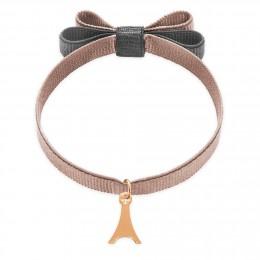 Bracelet ruban double nœud de couleur beige avec une tour Eiffel plaqué or