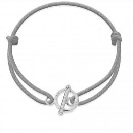 Bracelet avec fermoir rond en argent sur un cordon épais gris claire