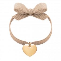 Bracelet ruban de couleur ivoire avec un cœur plaqué or