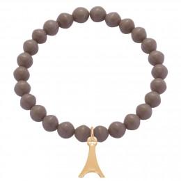 Bracelet en petites billes de cristal gris foncé avec une tour Eiffel plaquée or