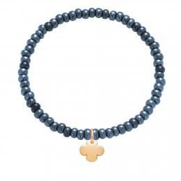 Bracelet en billes de cristal bleu marin opalisées avec un trèfle rond plaqué or