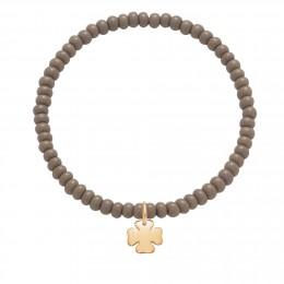 Bracelet en billes de cristal grises avec un trèfle plaqué or