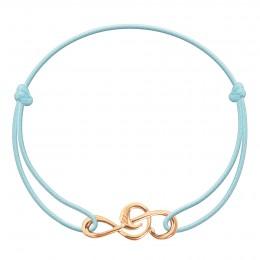 Bracelet avec clef de sol plaquée or sur un cordon fin bleu clair