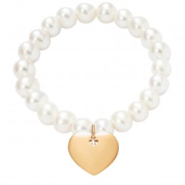 Bracelet avec un cœur doré et des grosses perles blanches