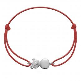 Bracelet avec un nounours en argent sur un cordon fin rouge