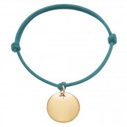 Bracelet avec médaillon plaqué or sur un cordon épais de couleur turquoise