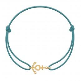 Bracelet avec ancre plaquée or sur un cordon fin bleu turquoise