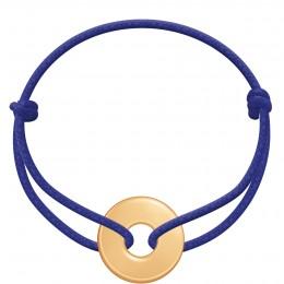 Bracelet avec un disque plaqué or sur un cordon épais bleu bleuet