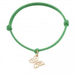 Bracelet avec papillon ajouré plaqué or sur un cordon épais vert gazon
