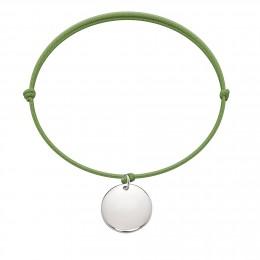 Bracelet avec médaillon en argent sur un cordon fin vert pomme