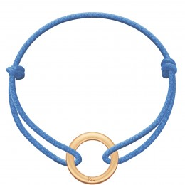 Bracelet avec un disque la Roue plaqué or sur un cordon épais bleu