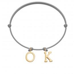 Bracelet OK, lettres plaqué or, sur cordon classique gris clair