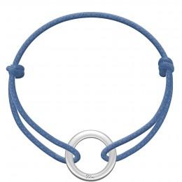 Bracelet avec un disque La Roue en argent sur un cordon épais de couleur jeans