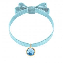 Bracelet avec pendentif quartz bleu plaqué or, sur ruban double noeud bleu ciel
