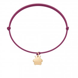 Bracelet avec ourson plaqué or sur un cordon fin de couleur fuchsia