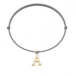 Bracelet avec lettre A en or 585 sur un cordon gris clair fin
