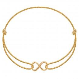 Bracelet avec un signe de l'infini en or585 sur un cordon épais doré premium