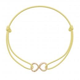 Bracelet avec un signe de l'infini plaqué or sur un cordon fin jaune