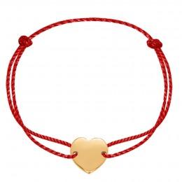 Bracelet avec un coeur plaqué or sur un fil rouge épais de première qualité