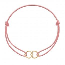 Bracelet avec des cœurs joints plaqués or sur un cordon fin rose